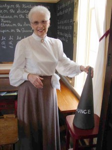 Doris Martin, a retired school teacher plays the role of one of the schoolmarms at the One Room School in Pittsboro..