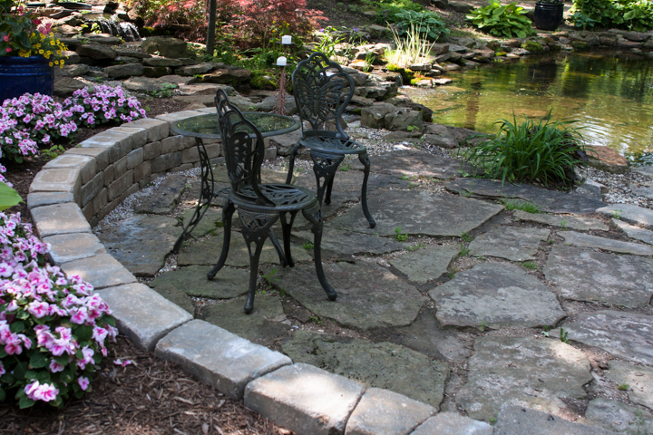 Reminiscent of a French patio, tables, chairs, and benches like these are placed throughout the grounds and welcome you to take a seat and relax.