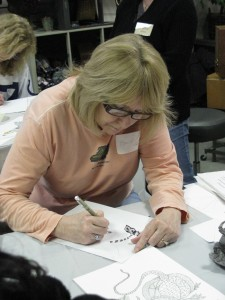 Billie Barton of Clermont works on a piece during the Zentangle class at Finer Things.
