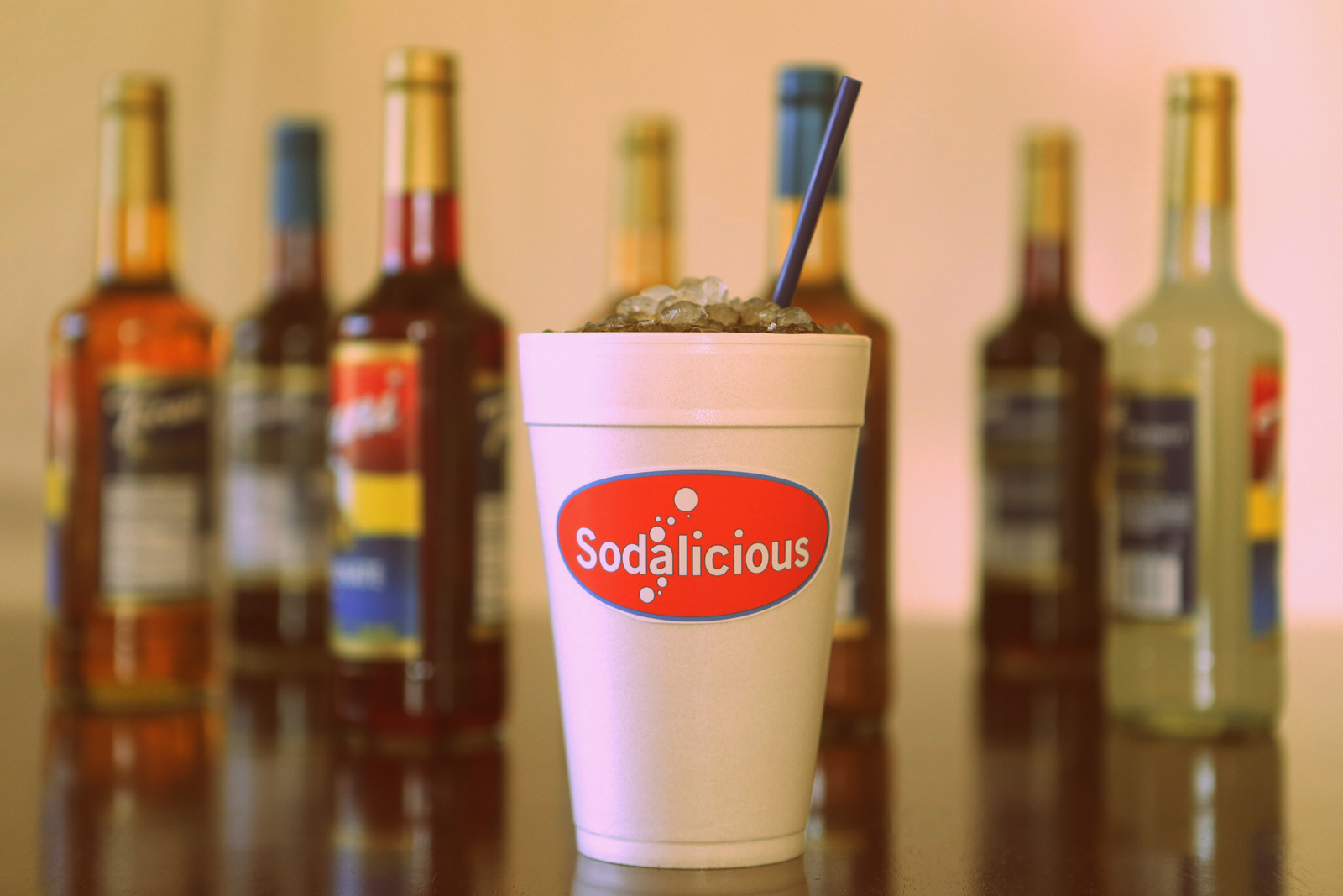 A Sodalicious cup on a table
