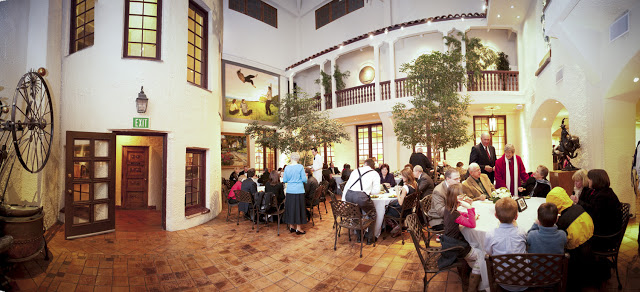 Wedding guests seated in the Atrium at the Springville Muesum of Art