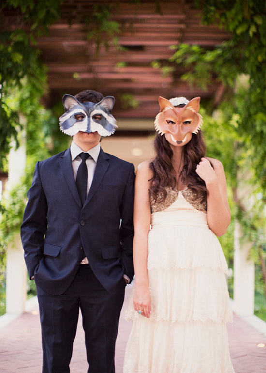 Wedding couple wearing animal masks