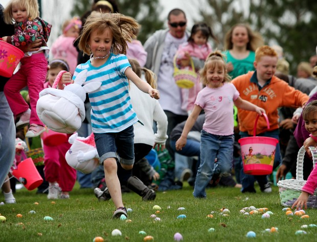 Crowds of kids and parents swarm a field during the state's largest Easter egg hunt at Thanksgiving Point.
