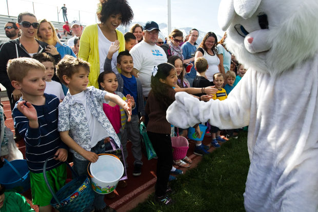 The Easter Bunny giving high fives to children