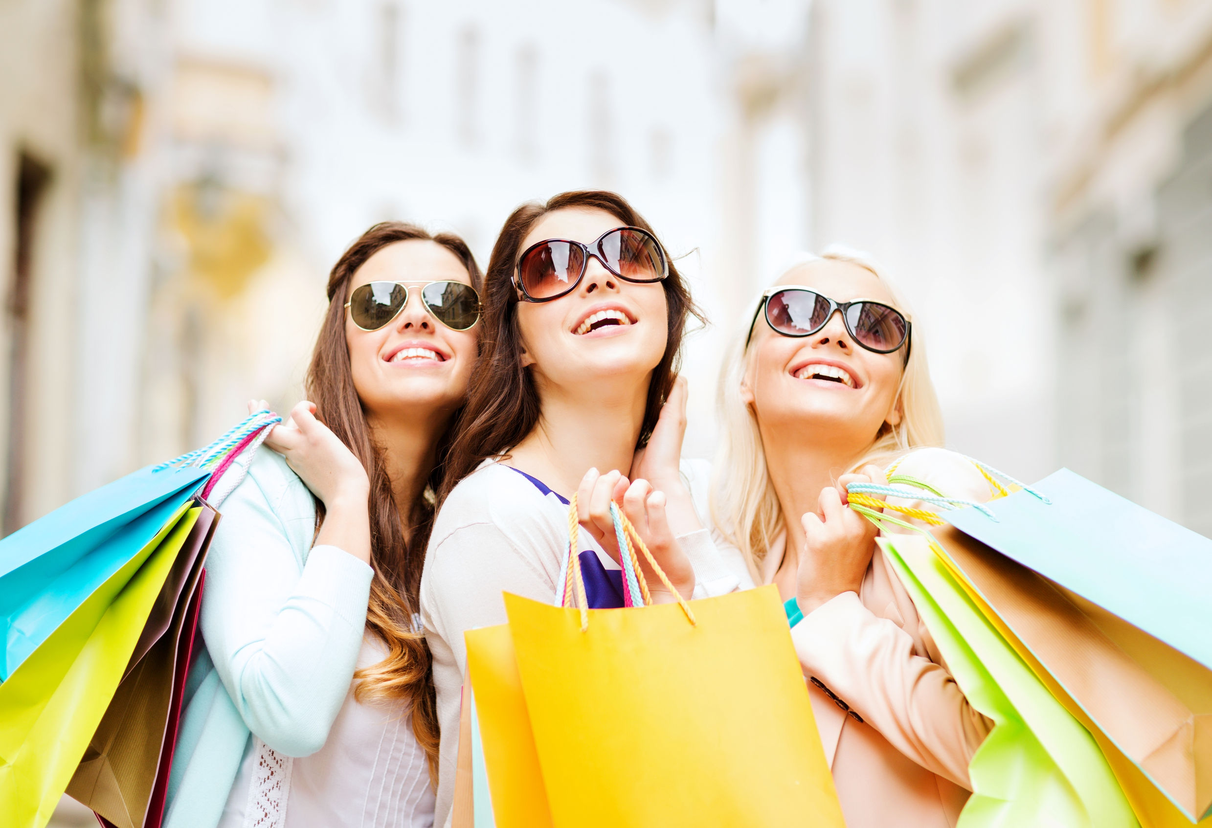 Girls shopping with colorful bags