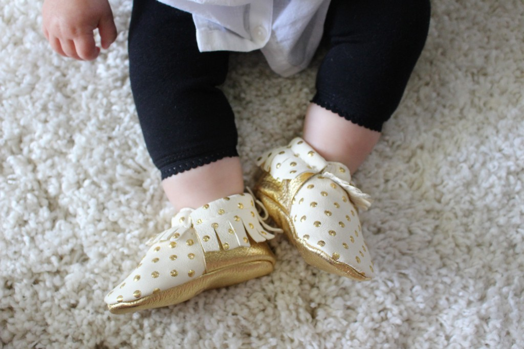 Baby wearing Freshly Picked moccasins
