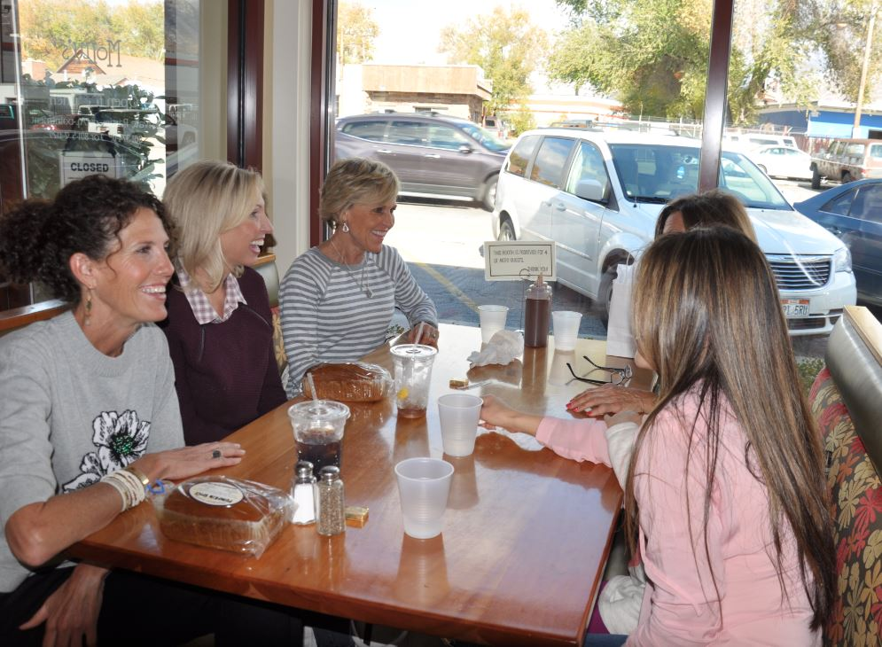 Family and friends eat together at Molly's