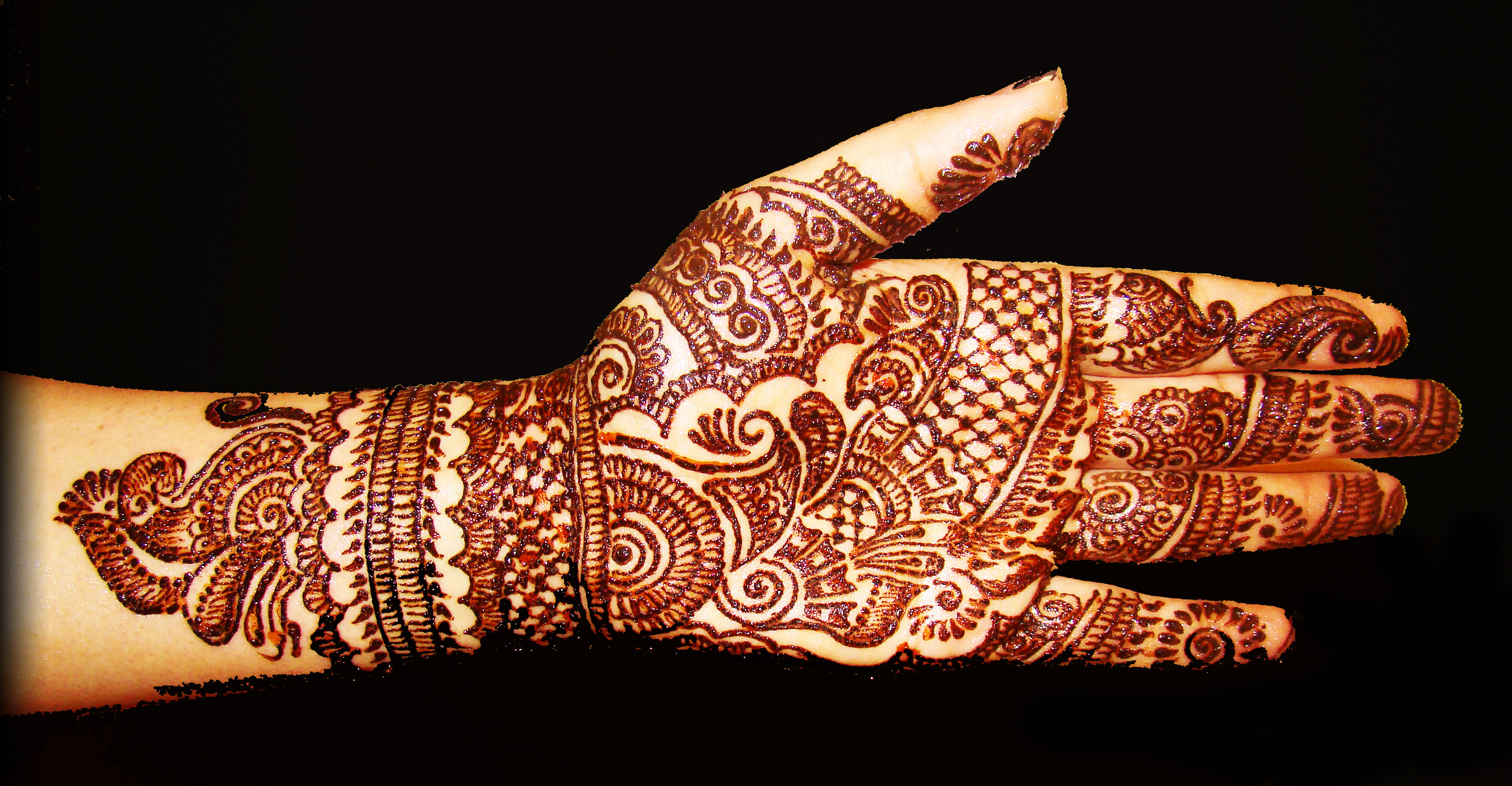 An arm decorated with henna designs