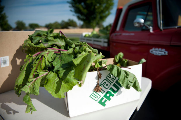 A box of greens at the Mapleton Farmer's Market