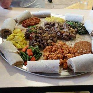 An Ethiopian feast at Samson's Market Bistro, surrounded by injera bread. Courtesy Samson's Facebook page.