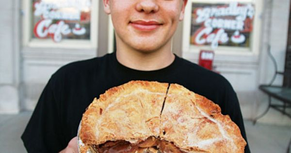person with pie in front of Bradley's Corner Cafe