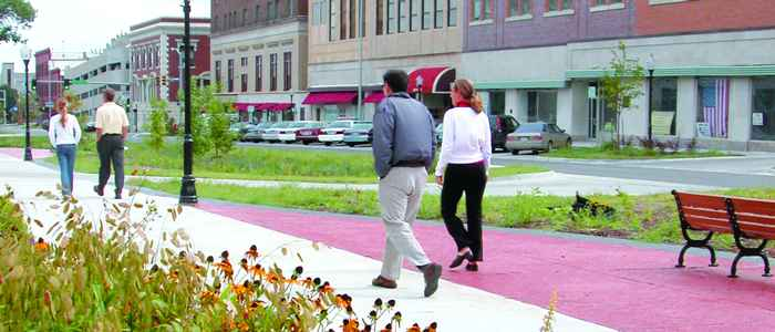Couples walking on a downtown sidewalk