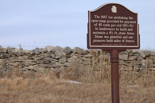 Limestone wall with historical sign
