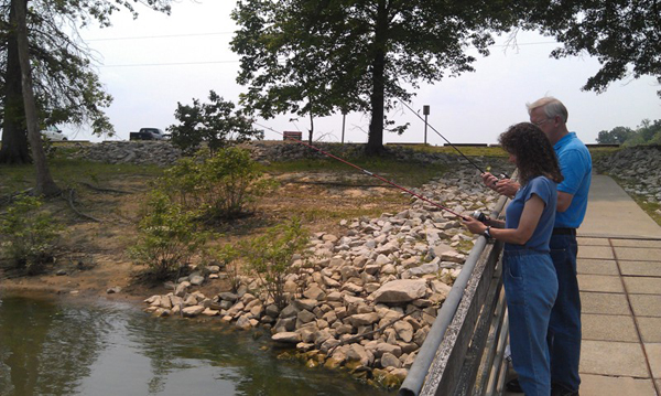 Visitors fish for bluegill off the dock at Paynetown SRA. Photo Credit: Jill Vance