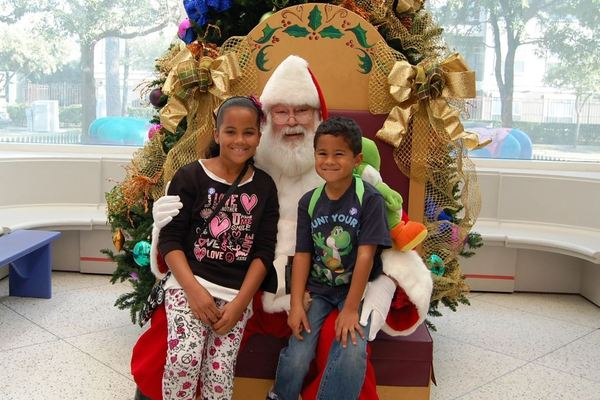Santa with kids at the children's museum