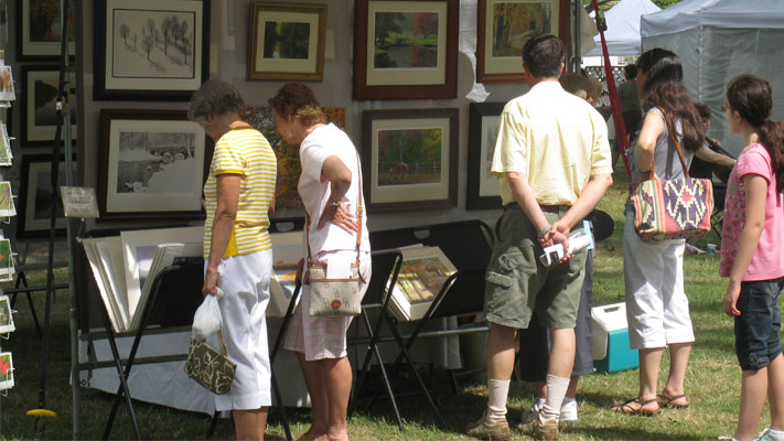 Art lovers browse the juried works at the Lansdale Festival of the Arts