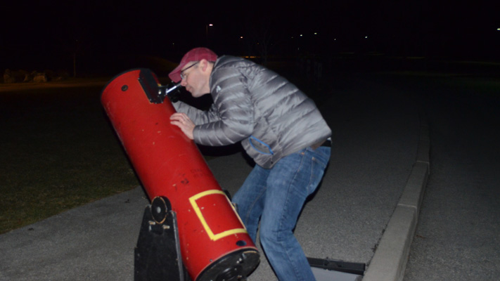 Rob Becker gazes into his telescope.