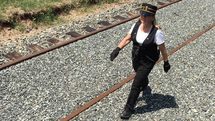The conductor is in charge of the train, and Bonny Mallon takes the responsibility seriously.