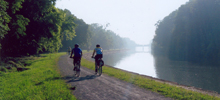 Cyclists along the Erie Canalway in Medina, by Debbie Stern