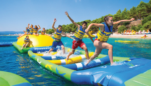 Passengers on Whoa Zone Whiting floating water park