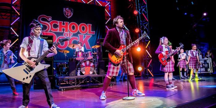 Stephen Leask and the kids cast of School Of Rock (Photo: Tristram Kenton)
