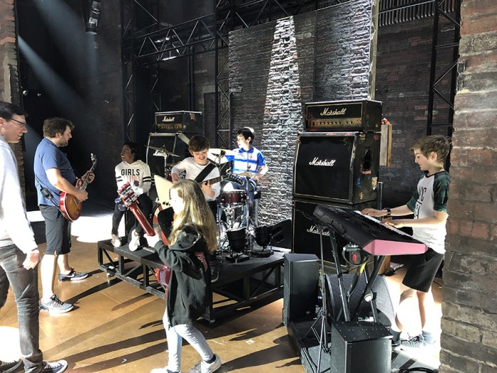 Members of the School Of Rock cast warming up