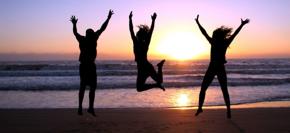 happy_people_jumping_sunset_beach