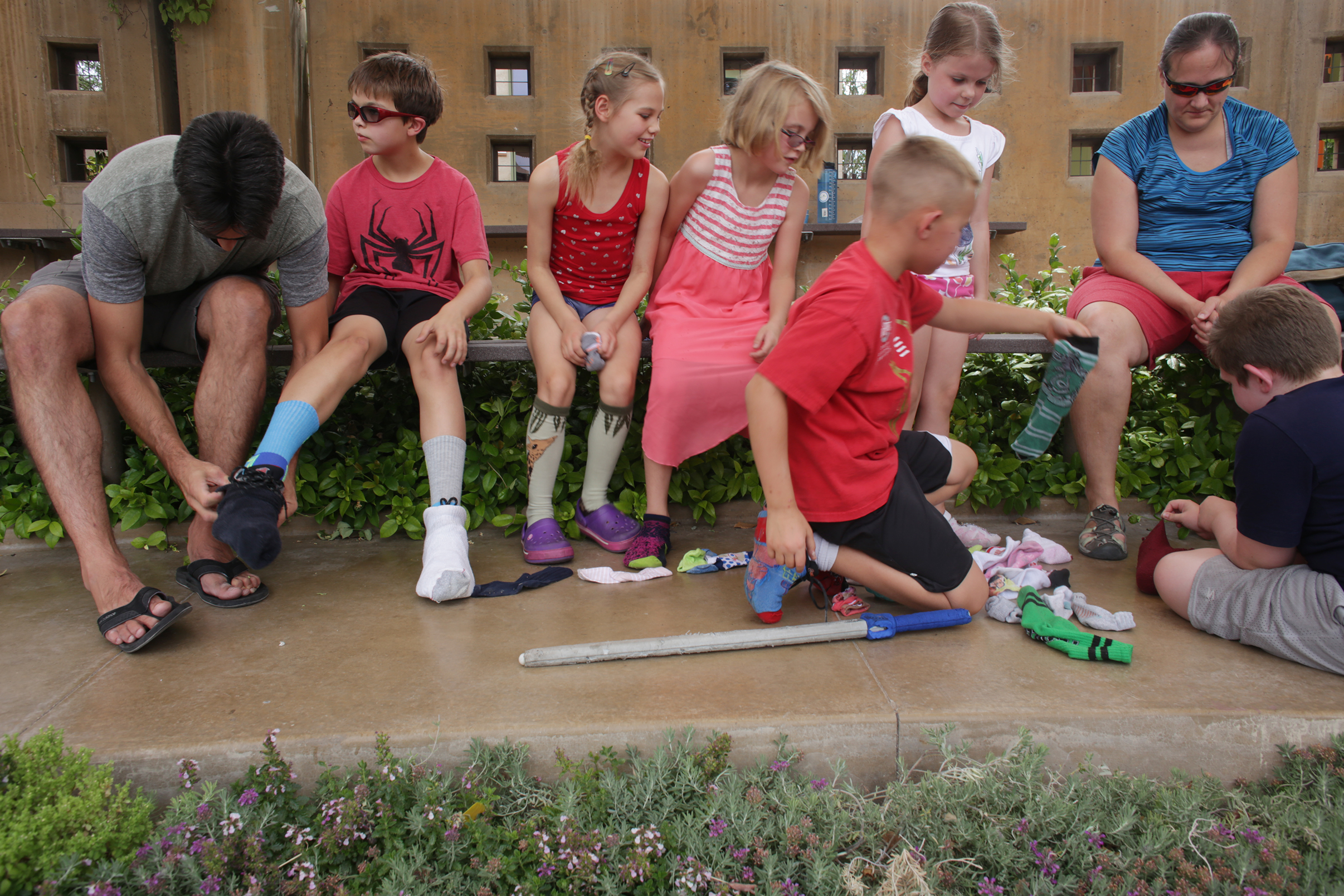 Students remove socks at the Springs Reserve