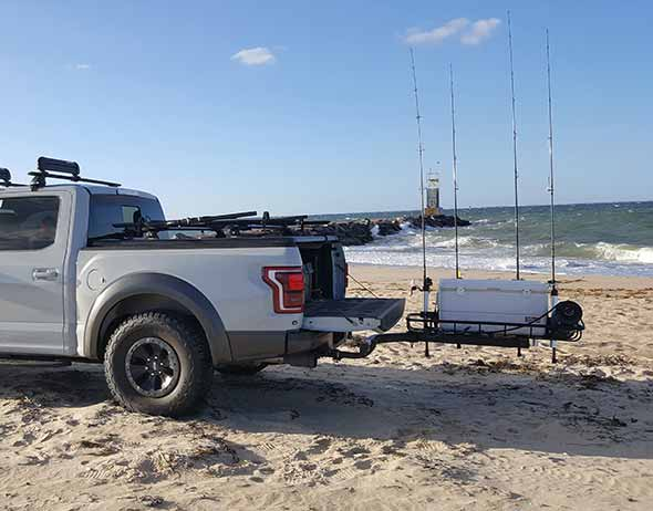 Ford pickup truck on the beach with StowAway Surf Fishing Rod Rack