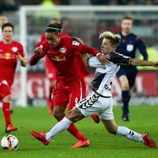 HAMBURG, GERMANY - FEBRUARY 12:  Marc Rzatkowski (R) of St. Pauli challenges for the ball with Yussuf Poulsen of Leipzig during the second Bundesliga match between FC St. Pauli and RB Leipzig at Millerntor Stadium on February 12, 2016 in Hamburg, Germany.  (Photo by Martin Rose/Bongarts/Getty Images)