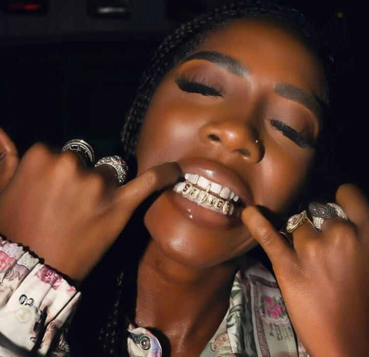 Tiwa Got Her Name Crested On Her Teeth