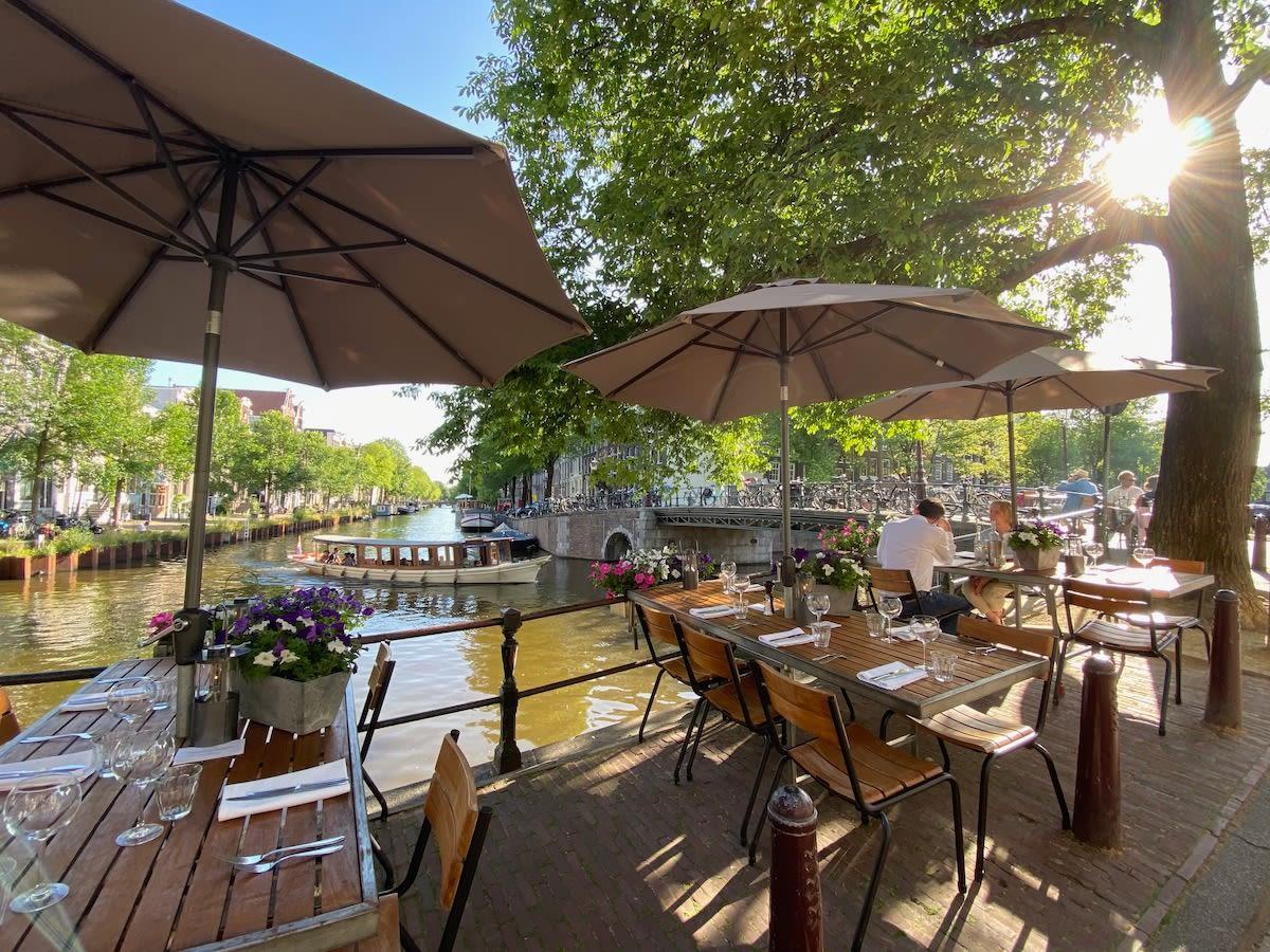 Historic Amsterdam restaurant De Belhamel has beautiful terrace on canal for outdoor lunch