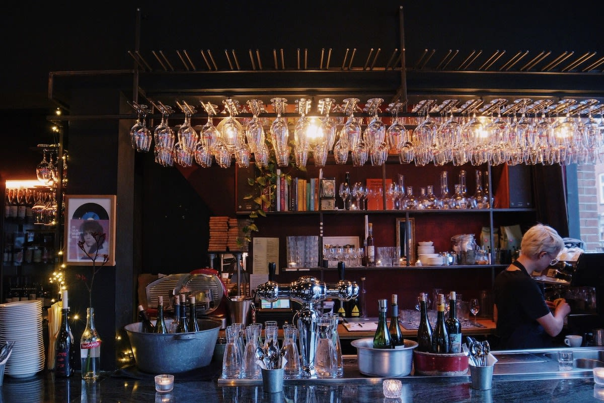 Natural wine bar, Bar Centraal, has many glasses and a friendly bartender ready to pour