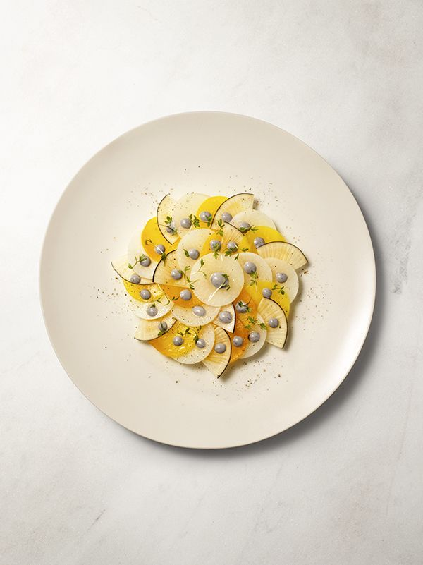 Top Amsterdam restaurant Cafe Caron's artfully plated salmon dish for at-home holiday dinner