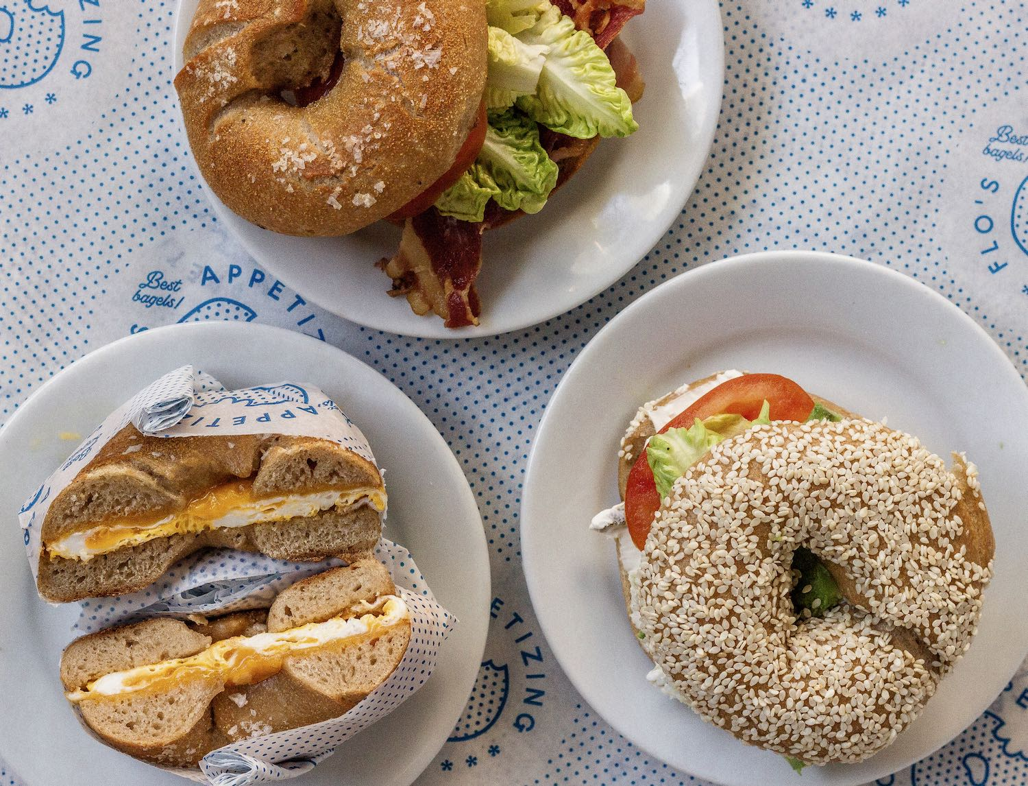 Amsterdam restaurant Flo's shows bagel sandwiches with egg, bacon, tomato, lettuce. Image for Table Sage