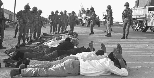 Israeli soldiers guard captured Egyptians and Palestinians captured in the Gaza Strip during the Six Days War.