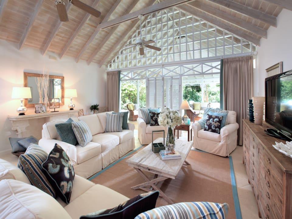 Great room opens through folding glass doors to verandah