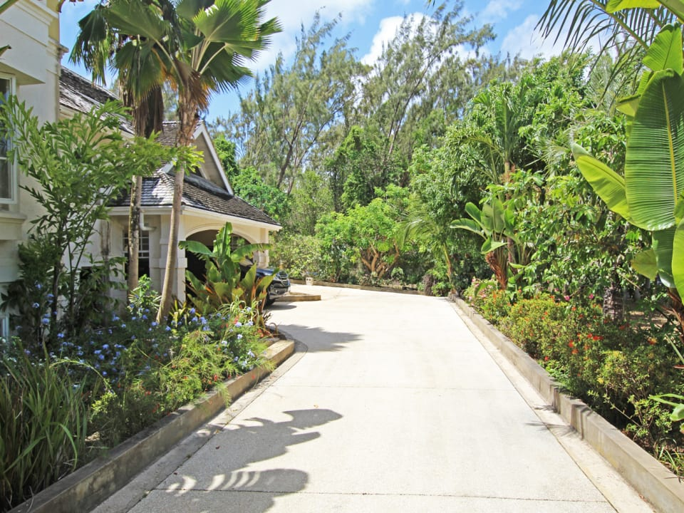 Driveway leading to car port