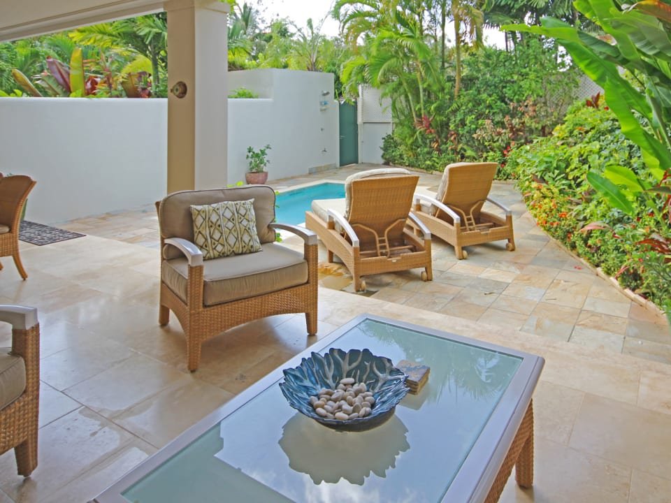 Outdoor patio area with pool