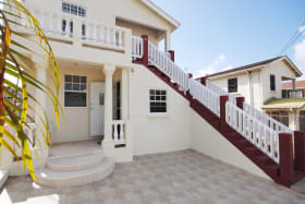 Entrance to ground floor apt and stairs to upper apartment