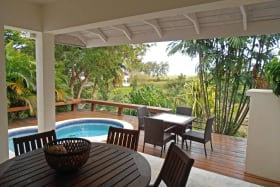 Covered patio with pool and wood deck dining area