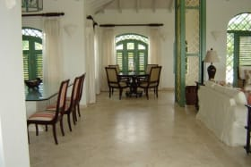 A SECTION OF THE DINING AREA & SITTING ROOM