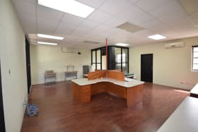 Open plan - private office to rear