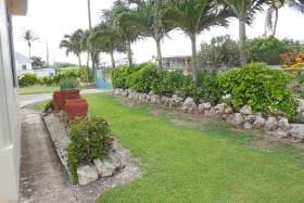 Garden leading to gated entry
