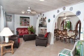 Living room opening to dining area and pool terrace