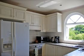 Kitchen with window and views