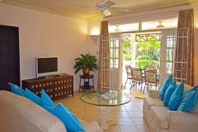Living room opens to covered verandah