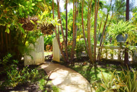 Private garden leads to the shared terrace and beach access