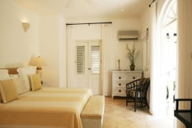 One of the guest bedrooms opens to a balcony and garden views