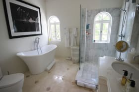 Master bedroom bathroom with marble finishes